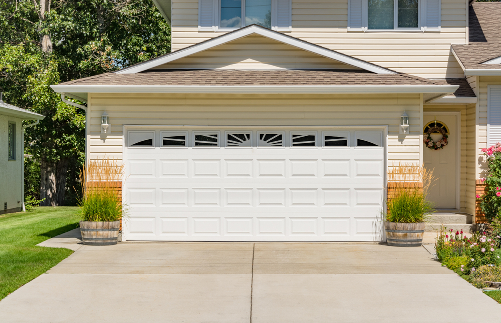 A-perfect-neighbourhood.-Family-house-with-wide-garage-door-and-concrete-driveway-in-front-2